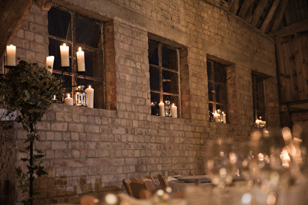 Candles on window ledges in barn