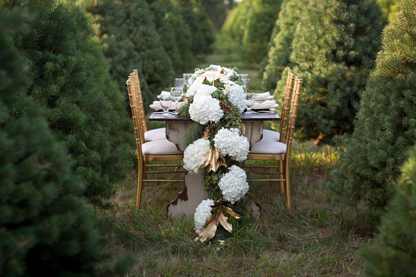 Wedding table with large floral centrepiece
