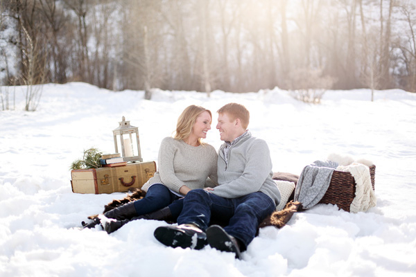 Couple having picnic in snow at Steamboat Springs, Colorado