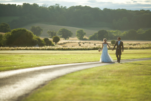 Bride and groom walking down St Audries Park driveway
