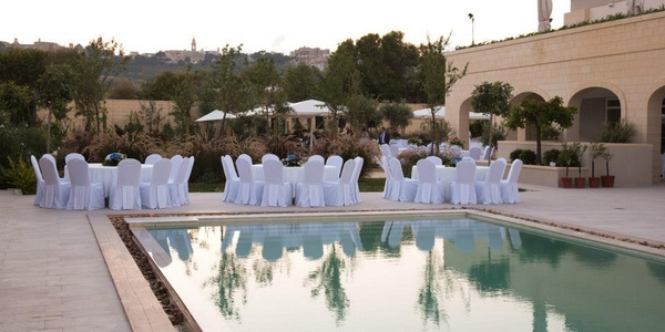 Reception Seating by Pool at The Xara Lodge Wedding Venue in Malta