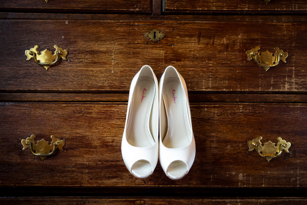 Brides shoes hanging from drawers