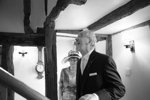 Father waiting for bride at bottom of stairs