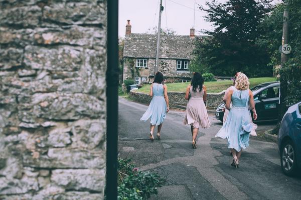 Bridesmaids walking to church