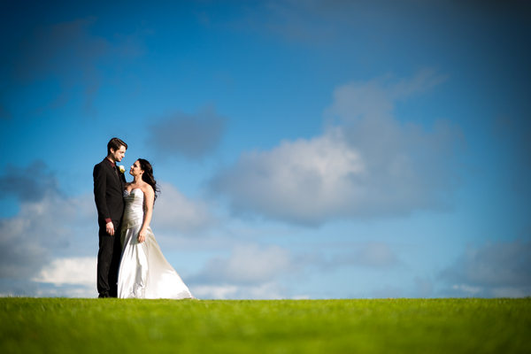 Bride and groom on top of hill