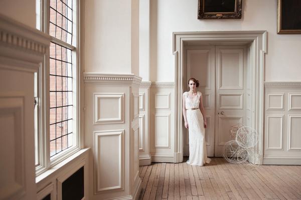 Bride leaning on door