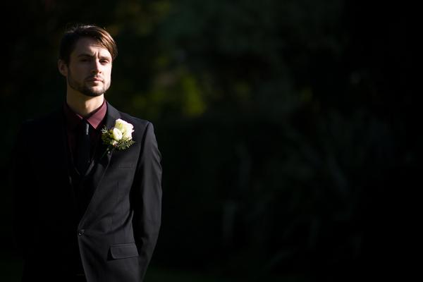 Groom in dark suit and burgundy short