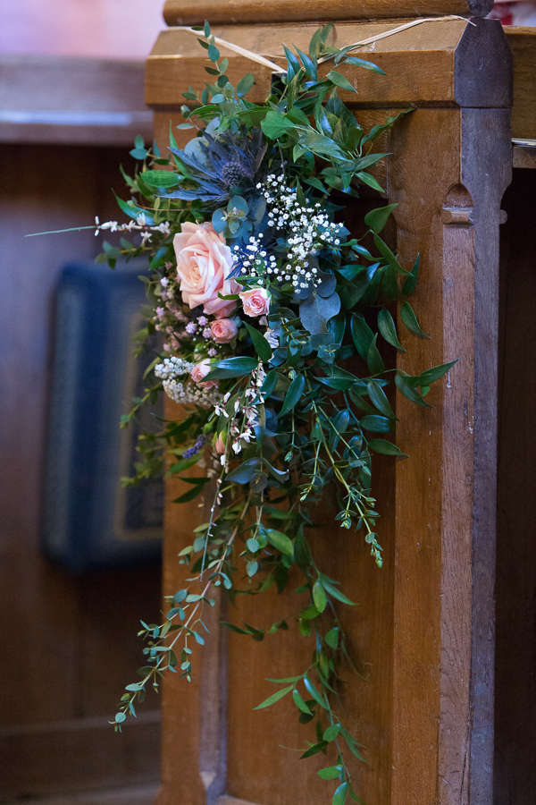 Flowers on end of church pew