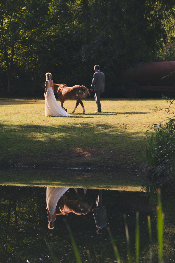 Bride and groom with pony