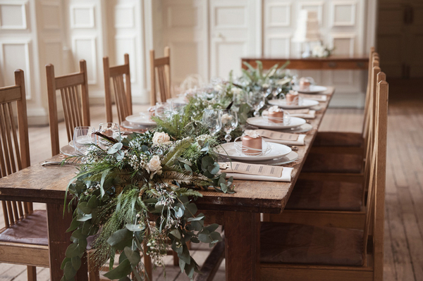 Wedding table with large foliage centrepiece