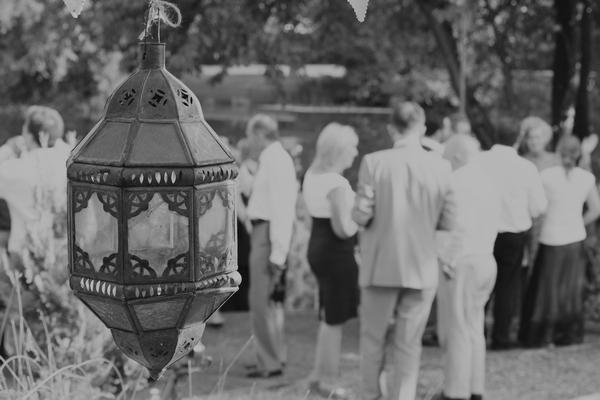 Wedding guests behind lantern