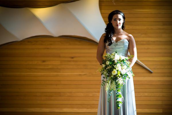 Bride holding cascading bouquet
