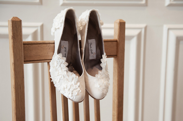 Wedding shoes on back of chair