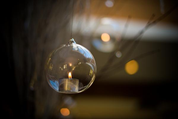 Tea light hanging from tree branch