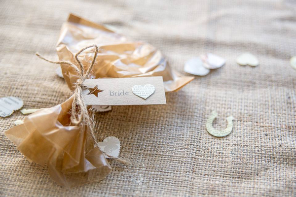 Rustic wedding place setting on hessian tablecloth