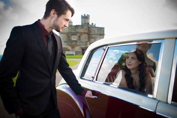 Groom opening car door for bride