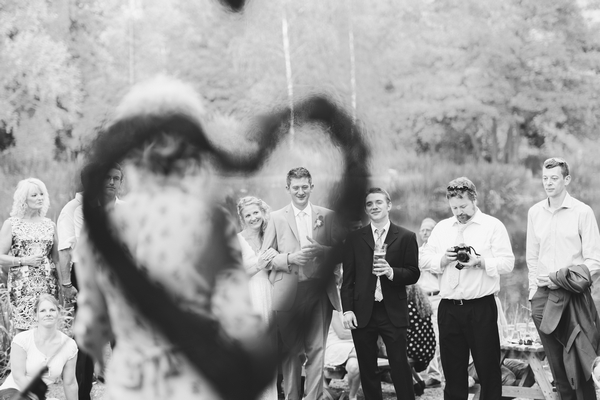 Bride and groom seen through hanging heart
