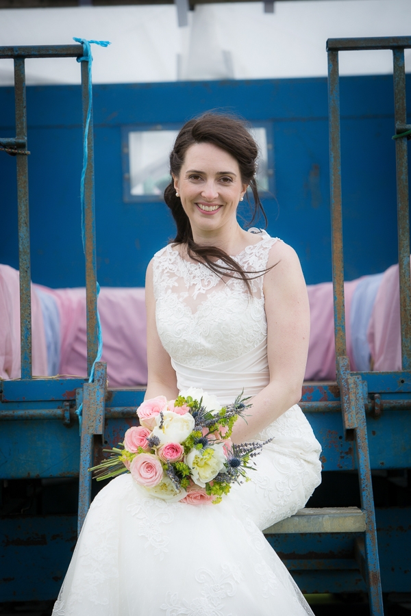 Bride sitting with bouquet