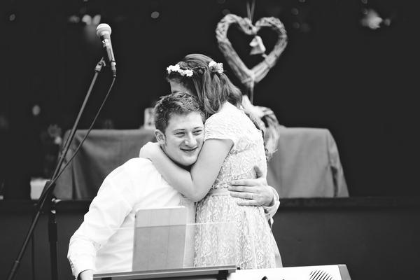 Man and girl hug