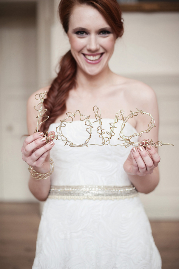 Bride holding wire Love sign