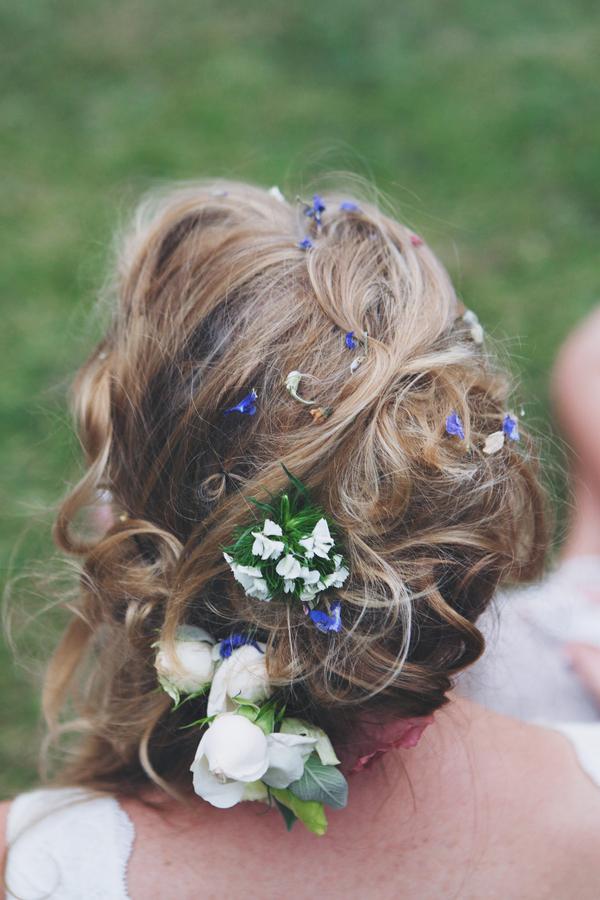 Confetti in bride's hair