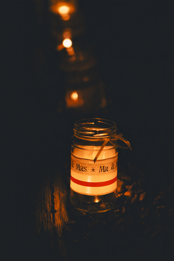 Jam jar with candle in