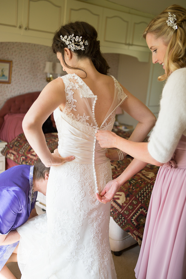 Doing up bride's dress