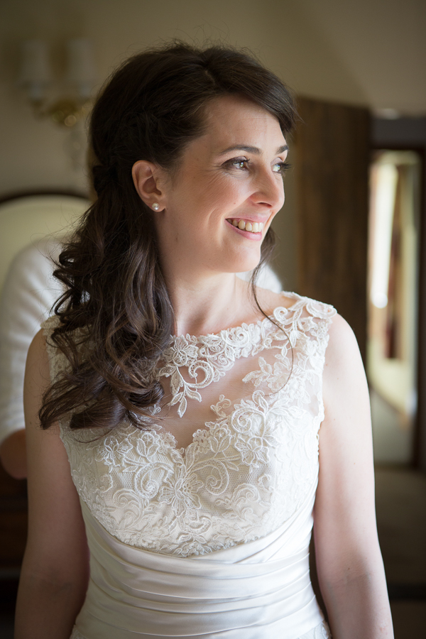 Bride wearing lace detailed dress
