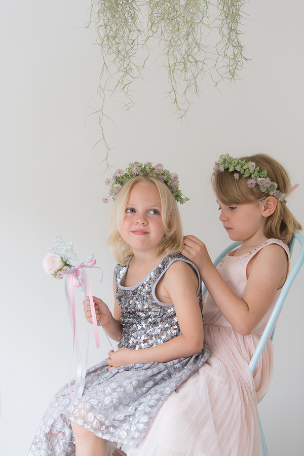 Flower girls sitting on a chair
