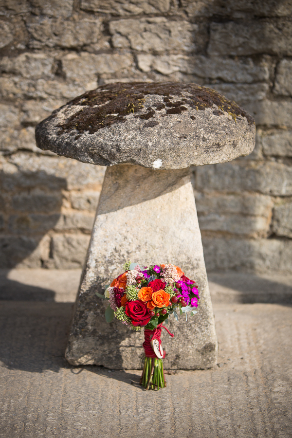 Stone stool with wedding bouquet