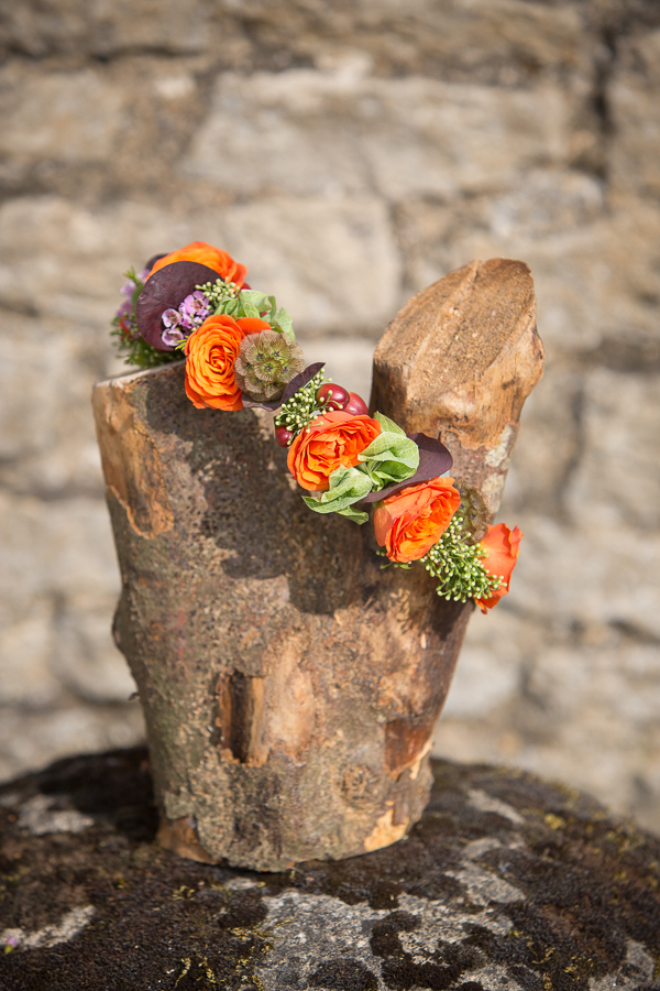 Log with wedding flowers