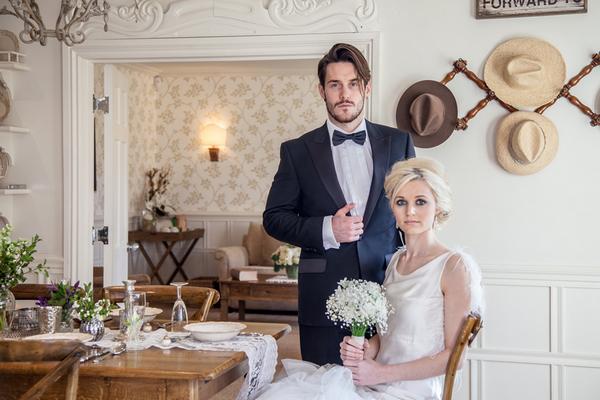 Elegant bride and groom sitting at table