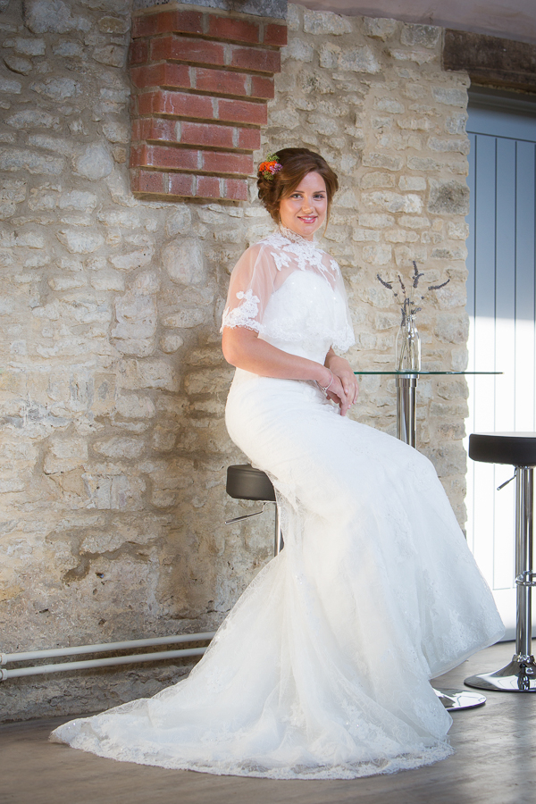 Bride sitting on stool