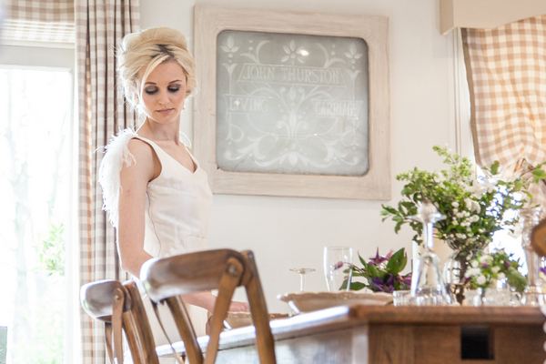 Bride standing at table