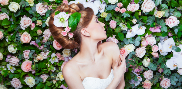 Bride turning to flower wall