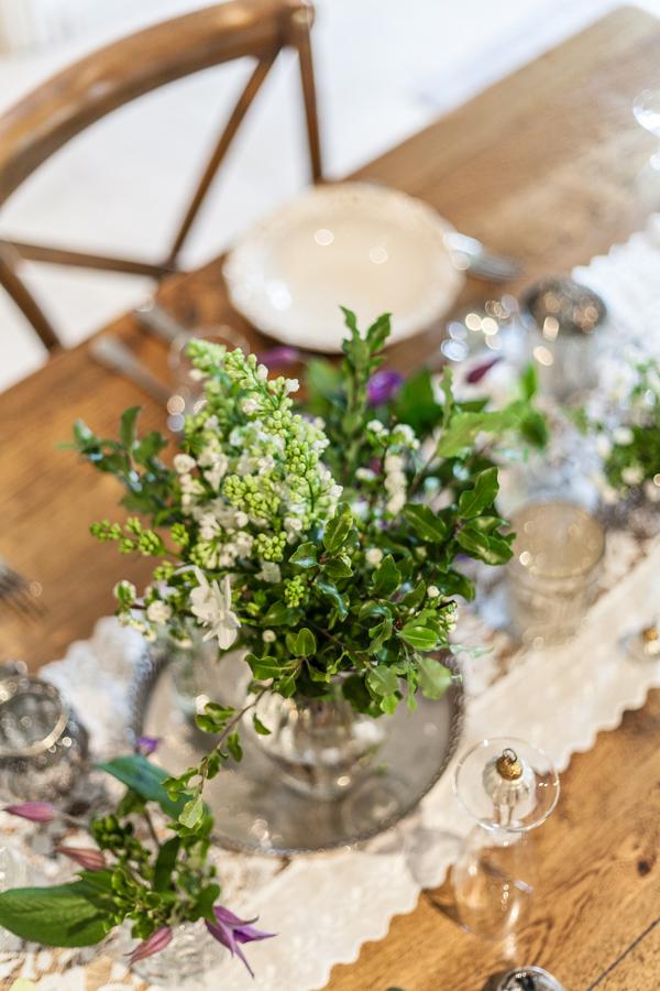 Vase of foliage on table