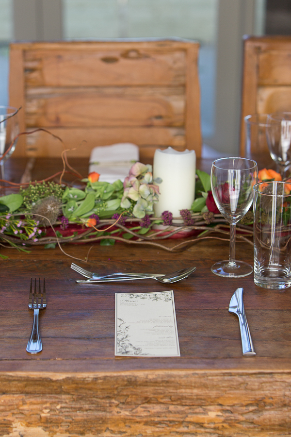 Wedding place setting on wooden table
