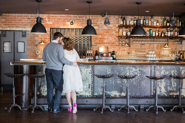 Couple standing at bar