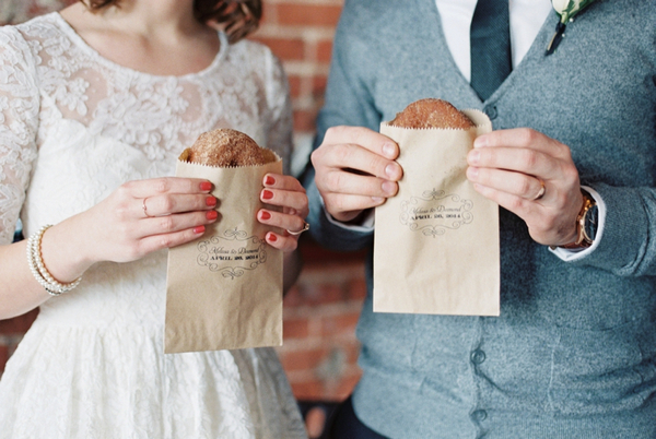 Couple holding donuts