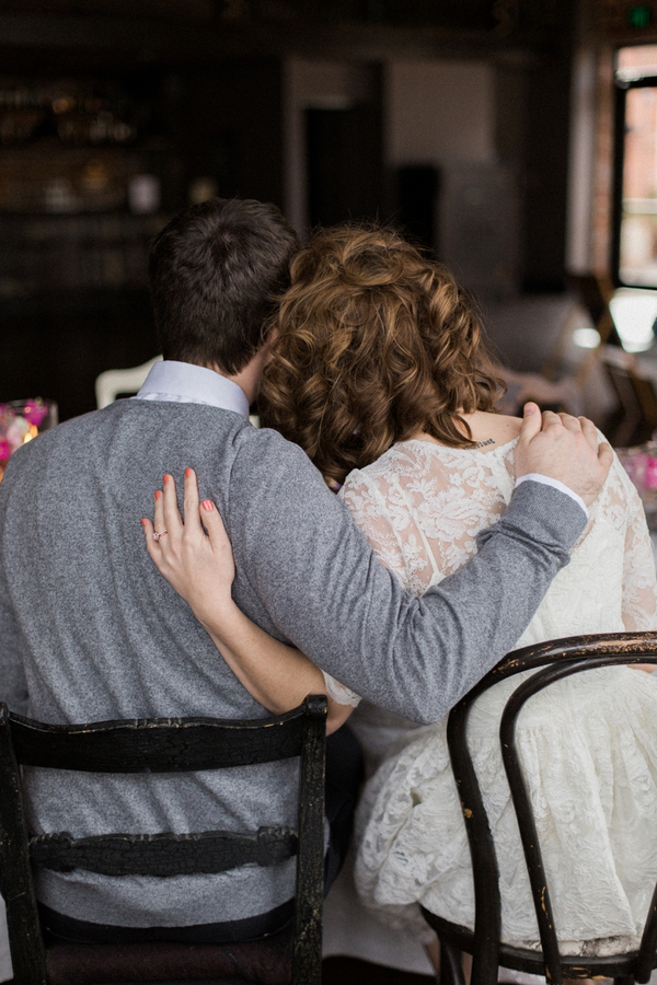 Couple with arms around each other