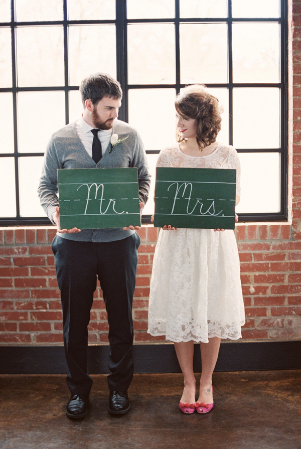 Couple holding mr and mrs chalkboard signs