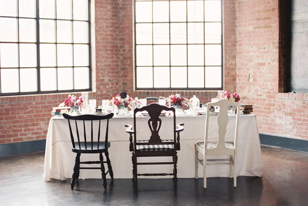Wedding table with mismashed chairs
