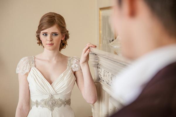 Bride looking across at groom