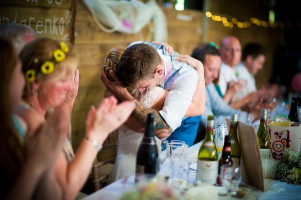 Bride and groom hug after speech