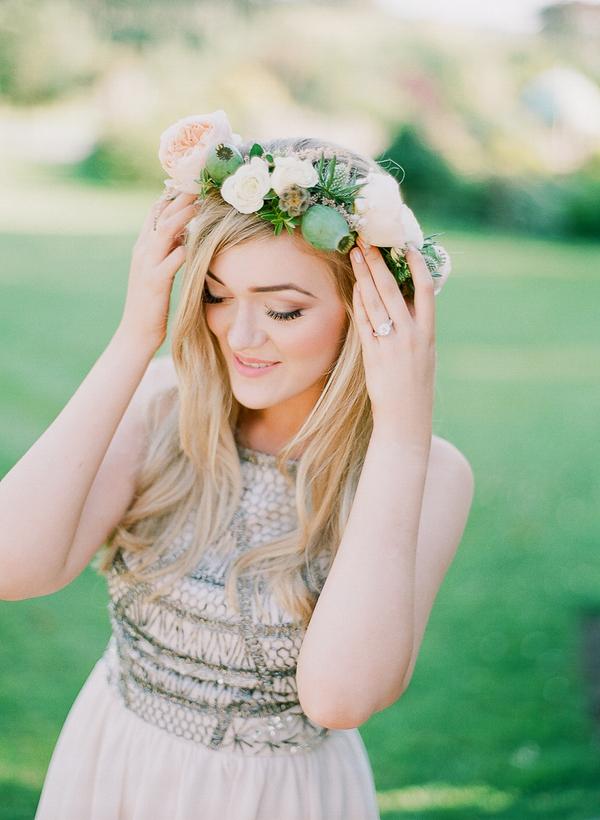 Woman adjusting flower crown
