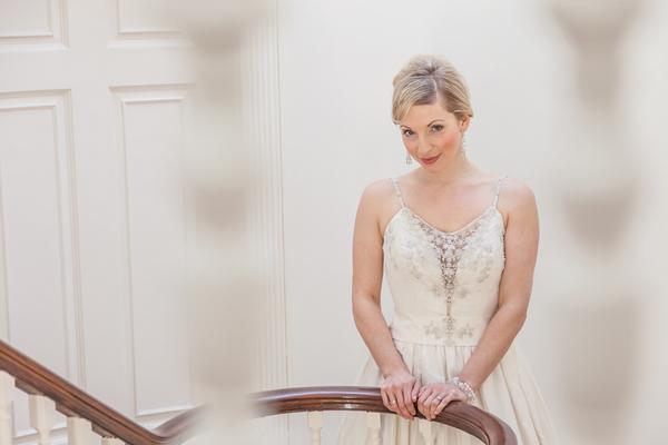Bride holding onto bannister