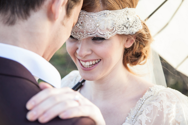 Bride with lace bridal headband smiling