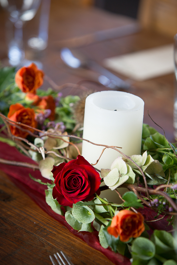 Candle and flowers wedding table centrepiece