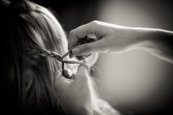 Bride having hair braided