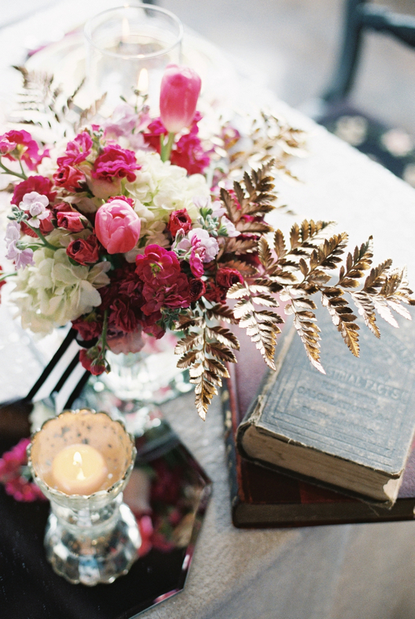 Flowers and books on wedding table